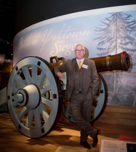 Peter Armstrong near Am Rev Museum Siege cannon